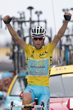 Nibali wins Stage 18, closes in on Tour victory - Italy's Vincenzo Nibali crosses the finish line to win the eighteenth stage of the Tour de France over 145.5 kilometers (90.4 miles) with start in Pau and finish in Hautacam, Pyrenees region, France, Thursday, July 24, 2014. (AP Photo/Peter Dejong)