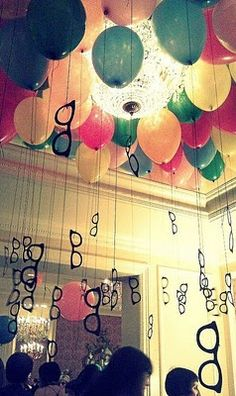 We are definitely doing balloons hanging from the ceiling, but we don't know what to hang from the balloons yet! Help?