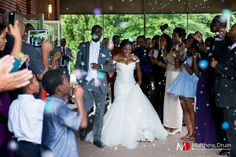 Bride and groom leaving wedding with bubbles during the day. NO TRAVEL FEES IN THE US!