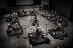 These past months we saw a few pictures on the Twitter feed of Junkie XL, showing some of the work he was doing with Hans Zimmer on the soundtrack for The Man Of Steel motion picture. The images were of a drum studio set up of twelve drum kits, all facing eachother. To us that looked very interesting.
