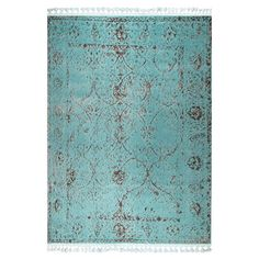 Instantly update your room with this turquoise rug featuring white tassels, perfect for adding texture to hardwood flooring or pattern to neutral carpets.