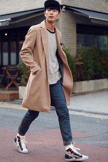 Two-Button Wool Top CoatComplete your professional look this cold season with this coat. Features notch collars, long sleeves, two-button closure, flap pockets, and slim fit. Layer this over a suit ensemble and wingtip leather shoes.