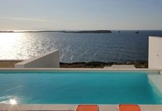 This is a large contemporary 6 bedroom waterfront property, divided into two units and overhanging the sea like a white sailing vessel, with a spectacular view on the blue shades of the Aegean sea, the northern side of Antiparos and the breathtaking sunse