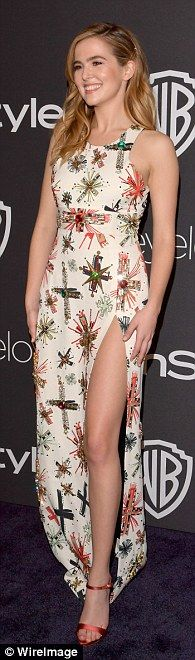 Leg's eleven: Zoey Deutch also put on a leggy display in a fashion forward gown with cross...