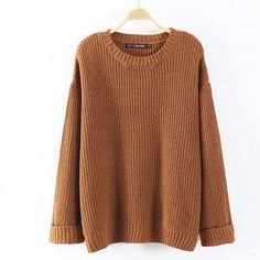 Long knit sweater with oversized look. Made with a blend of cotton & polyester. Onesize fits most, measures: Bust 45 inches, Length 23 inches. Ships from New York.