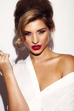 Red lipstick and flawless skin.