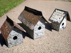 birdhouses made from recycled tin ceiling tiles