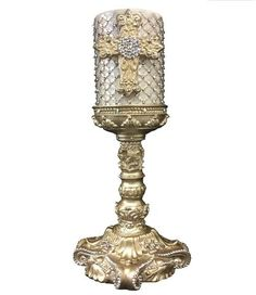 Sir Oliver& by Reilly-Chance Collection offers a Hand Poured, Triple Scented, Candle with Jeweled Mesh that is topped with a jeweled cross. It sets perfectly on our Jeweled Unique Candles, White Candles, Candle Arrangements, Scented Oils, Gold Light, Christmas Shopping, Candlesticks, Iridescent, Swarovski Crystals