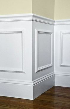 Creative ideas. Wood trim and molding create the look of wainscoting in this bathroom. The wall and wood trim are both painted white to create the illusion of custom millwork