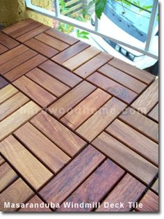 Wood Deck Tiles....a terrific makeover for concrete patios, balconies, etc. Lays right over existing surface.