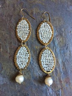 A personal favorite from my Etsy shop https://www.etsy.com/listing/279269304/freshwater-pearl-gold-hoop-statement