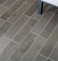 These grey limestone tile are throughout the kitchen and dining room.