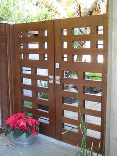 Double wooden gate in contemporary style in Tiburon, CA. Gate designed and built by Prowell Woodworks. Gate hardware is the Moda Latch by 360 Yardware, as well as a stainless deadbolt and a cane bolt for the fixed gate.    Moda Contemporary Modern Stainless Steel Gate Latch Lever Latch