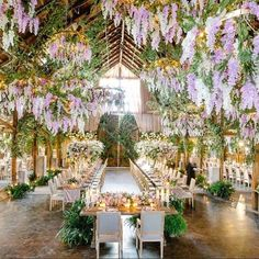 This barn by @whitelilacinc is a total dream...how amazing to dine under all this wisteria right?!   Stunning work by this team: @yseidod @casadeperrin @latavolalinen @hensleyeventresources @ambereventprod @theonicollection @rebeccareateguiweddings   #GWSweddingartist
