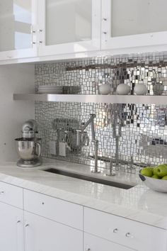 Glamorous metallic backsplash tile in all white kitchen with sleek prep sink.