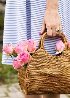 straw bag of roses