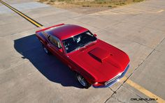 1969-Ford-Mustang-Boss-429-Fastback-in-Candyapple-Red-9.jpg (2300×1450)