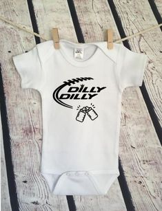 Super bowl Dilly Dilly Football Adorable Customizable Baby Girl or Boy Onesies Bodysuit- Funny Onesies Bodysuit- Baby Bodysuit Great baby shower gift for a new baby Heat transfer vinyl is used for the design and it is applied with a commercial grade press. We use Laughing Giraffe Cotton Blend Onesies or Bodysuits #babyclothesboy
