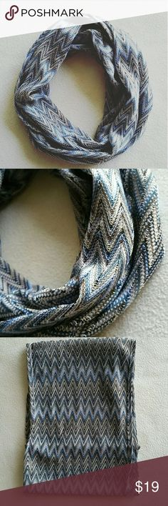 Bluish Gray Infinity Scarf Chic bluish Gray V patterned infinity scarf. OSFM. In excellent like new condition. Always fashionable. Lightweight so you can wear year round. 100% Polyester. Please let me know if you have any questions. 30% discount when using the bundle feature. No trades! Goensshopping  Accessories Scarves & Wraps
