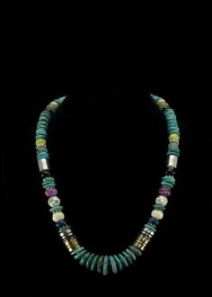 "Tommy Singer Large Bead Necklace  Sterling silver and 12K gold filled barrel beads. Genuine Turquoise, Black Onyx, Surgilite, blue Lapis and Jasper beads.. Necklace is 21"""" and comes with a certificate of authenticity from the Native American artist.   http://www.sterlingjewelrystores.com/product341.html"