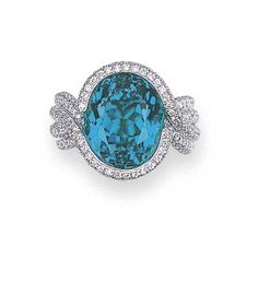 AN EXCEPTIONAL PARAIBA TOURMALINE AND DIAMOND RING    Set with an oval-cut Paraìba tourmaline weighing 8.90 carats in a pavé-set diamond surround, gallery and entwined four-band shoulders, mounted in platinum