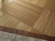 Bespoke Engineered Wooden TilesThese beautifully crafted Bespoke Engineered Wooden Tiles are from Italian manufacturer Quadrolegno. Available in a variety of different woods and finishes, as showcased below, these tiles are completely customisable; allowing you to create any specific look that you desire.