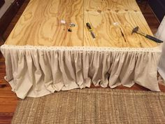 She nails drop cloth to a plywood frame. The reason? LOVE this idea!