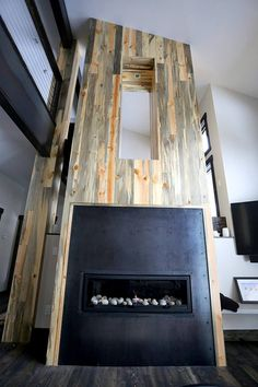 Beetle kill pine fire place accent wall from Sustainable Lumber Co.