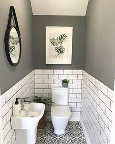 The little room with a wonderfully big tiling solution. bother the metro wall tiles with coloured grout and the patterned floor tiles. Patterned Floor Tiles, Small Toilet Room, Wc Ideas, Small Toilet, Bathroom Flooring, Inexpensive Bathroom Remodel, Bathroom Inspiration, Downstairs Toilet, Easy Bathroom Decorating