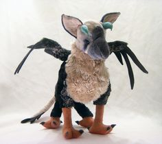 The last Guardian was such a beautiful game, and Trico is an adorable creature with great personality, so I couldnt resist making a plush of the feather-baby, and Im making him available as a made-to-order item.  This plush is made to be perfect to hug and snuggle, he is about the size of a housecat, being 10 high at the shoulder and 14 long with a 18 wingspan. He is filled with silky soft polyfil stuffing and can be posed to sit, stand, and lay down. My Trico is made of quality fabrics…