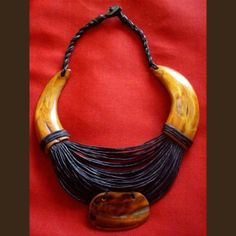 Ethnic necklace of fine leather cords and warthog tooth