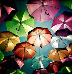 Google Image Result for http://images.wordlesstech.com/wp-content/uploads/2012/07/Colorful-umbrellas-in-the-air-1.jpg