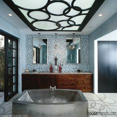 Wall tile by Oceanside Tile creates the focal point of this bathroom