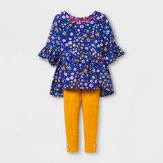 Your little one will be as bright as a spring flower any time of year when she's wearing this Challis Blouse and Pants Set from Cat & Jack™. The bright golden-yellow leggings and colorful floral-patterned top are perfectly springy, while the longer sleeves and full leggings are easy to transition to cooler weather. The loose-fitting shirt and stretchy leggings will keep her comfortable no matter what she's doing.