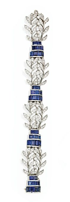 PLATINUM, SAPPHIRE AND DIAMOND BRACELET, SEAMAN SCHEPPS, CIRCA 1950. Designed as four foliate sprays of round and single-cut diamonds weighing approximately 4.50 carats, joined by three-row segments of calibré-cut sapphires, length 6¾ inches, signed Seaman Schepps. #diamondbracelets