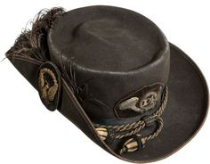 """Union Officer's Slouch Hat. Fine wool felt hat with a 1/4"""" woven silk tape band along the outer edge of the brim. Black ostrich feather plume that curves around to the back of the hat. Insignia on the front with gold bullion embroidered infantry horn with separately affixed false embroidered number """"104"""".  Attached to the turn up on the side of the hat is a beautiful Hardee officer's hat insignia of black velvet with bullion embroidered eagle with wings highlighted with sequins."""