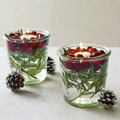 Love these! Rosemary, cranberries, and a floating candle in a small glass.