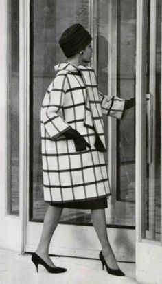 1959  Model in 910th white wool coat with large black tiles, features loosely tied removable scarf, by Givenchy, photo by Pottier,