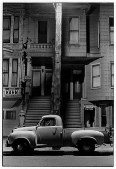 Pickup truck parked in front of duplex building at night. William Gedney.