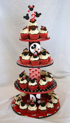 I love how this turned out. I had tons of fun making the stand. I'm glad our friend asked me to do this project. The cupcakes are chocolate fudge filled with marshmellow cream. (chocolate mouse cake how to make) Bolo Da Minnie Mouse, Bolo Mickey, Mickey Mouse First Birthday, Mickey Mouse Clubhouse Birthday Party, Mickey Mouse Parties, Mickey Party, 1st Birthday Parties, Disney Parties, Birthday Cupcakes