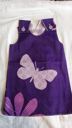 Schuerzenkleid lila Schmetterling