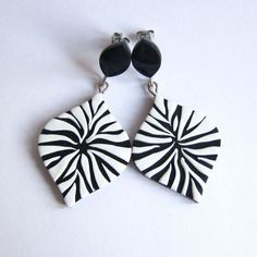 Black and white zebra earrings! They are entirely handmade by me. I made them with polymer clay. - Earring studs are stainless steel. - Earrings measure 5,3 cm long, 2,1 in big - I can make those earrings especially for you in another size or color. - All jewelry will come packed in their