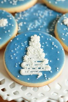 25+ Best Easy Christmas Cookies Recipes to try this year during the Holidays! | Decorated Christmas Sugar Cookies | Image © The Cafe Sucre Farine | Looking for Christmas cookie ideas for a party or cookie exchange? Whether you want easy Christmas cookies recipes for kids (like homemade cookies and no-bake), fancy cookies (like slice-and-bake and dipped cookies), or unique Christmas cookies that will truly impress, you'll find them here! #christmascookies #christmascookierecipes #homemade