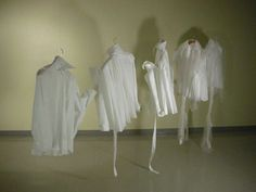 Ying Gao - Index of Indifference (2006) - The number of internet users who vote daily through interactive opinion surveys that are indifferent to political, economic or cultural issues shocked Ying. With a software program, she compiled and manipulated this statistical data concerning neutrality in order to modify the basic structure of 10 men's shirts over the course of four weeks.