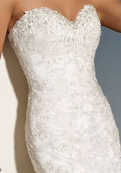 Love the lace, beading, and shape of this Sophia Tolli dress