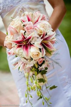 Add pink lilies for a pop of color to your wedding bouquet. White Wedding Bouquets, Diy Wedding Flowers, Bride Bouquets, Bridal Flowers, Floral Wedding, Bridal Bouquet Diy, Lilly Bouquet Wedding, Wedding Ideas, Flower Decorations