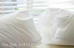 turn a regular size (bedroom) pillow into two throw pillows. love this! much cheaper than buying the premade filler ones
