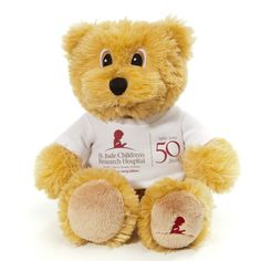 The official St. Jude 50th Anniversary Bear. Cute and super soft, and dressed in a white St. Jude tee that commemorates 50 years. The St. Jude Child Head logo is embroidered on his left foot.