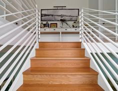 The Barn Reborn: Mark Zeff's House in East Hampton | Stair railings are painted steel. #design #interiordesign #interiordesignmagazine #architecture #staircase #decor