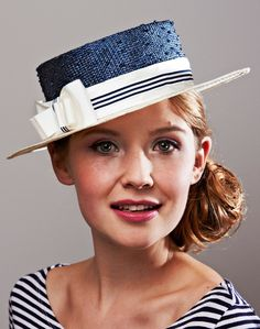 Charlie | Label: Lisa Tan Millinery | Spring/Summer 2012 | Two-tone boater with knotted sisal crown and parasisal brim, trimmed with silk and stripe ribbon band and bow